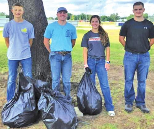 """CALDWELL FFA STUDENTS participated in the FFA Texas """"Day of Service"""" at the 93rd FFA State Convention.  Cooper Odenbach, Laramie Pieper, Caylee Garza and Dyson Drgac volunteered to help clean up a park in Fort Worth."""