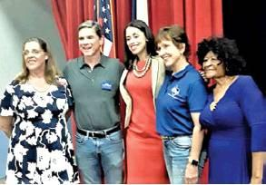 DEMOCRATIC PARTY Chairwoman Linda Arbuckle, left, and Mable Davis, right, join Rick Kennedy, Amanda Edwards and Barbara Gardner at the Taco Town Hall Meeting.
