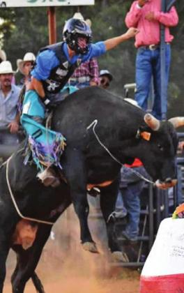 LANCE LARA COMPETES in the J-Rich Memorial Bull Riding Benefit where he received the highest marked score in the long round.