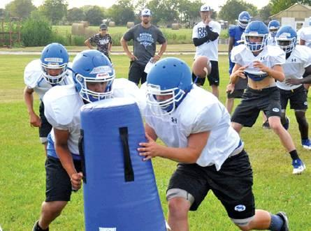 THE SNOOK BLUEJAYS work on their plays during a recent practice session. Snook is getting ready to open its season on Aug. 30 against Granger in Granger. -- Tribune photo by Roy Sanders