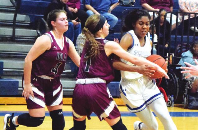SNOOK'S JAIVAN STRINGFELLOW is fouled while trying to dribble around Iola's Ava Pointer during the Lady Jay's 46-27 District 26-2A win over the Iola Lady Bulldogs last Tuesday night. Stringfellow scored seven points for Snook in the victory. -- Tribune photo by Denise Hornaday
