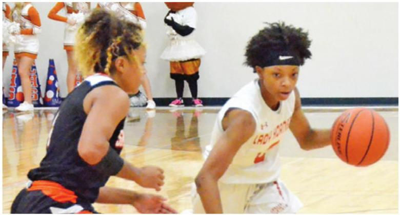 CALDWELL FRESHMAN POINT guard Ja'Asia Mathis led Caldwell in scoring against Smithville in Friday's night home game with 18 points. The Lady Hornets lost 49-46. -- Tribune photo by Roy Sanders