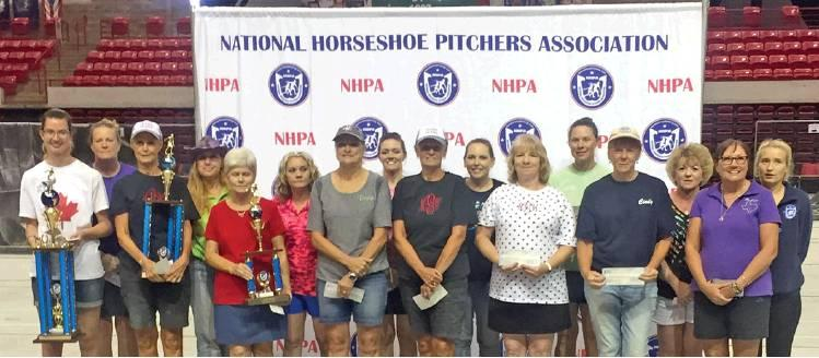 DORIS HIEDEN OF CALDWELL, seventh from the left, placed fourth in the world competition of the National Horseshoe Pitchers Association annual tournament in Wichita Falls. She is also a multiple Texas state champion and will compete again this fall for that title.