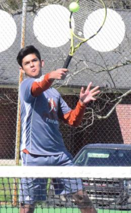 ISAAC SALAZAR backhands the ball at the Rockdale Tiger Classic Tennis Tournament on Friday. -- Tribune photo by Denise Hornaday