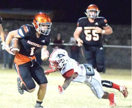 SOMERVILLE'S PHILIP HABA avoids getting tackled by a Burton defender during a quarterback keeper during Friday night's Somerville-Burton game at The Rock. -- Tribune photo by Denise Hornaday