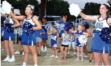 THE SNOOK MINI-CHEERLEADERS JOINED the Snook High School varsity cheerleaders in a dance and a couple of cheers to get the Snook faithful excited for the school year during Monday night's Meet the Bluejays at Snook City Park. -- Tribune photo by Denise Hornaday