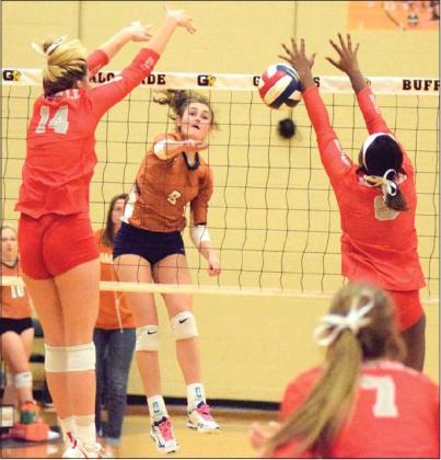 CALDWELL'S CORINNE DILLARD gets a kill during the Lady Hornets' tie-breaker seeding match against Bellville on Friday night in Giddings. Bellville won the match and earned the top seed from District 26-4A for the UIL Class 4A Volleyball Playoffs which began this week.