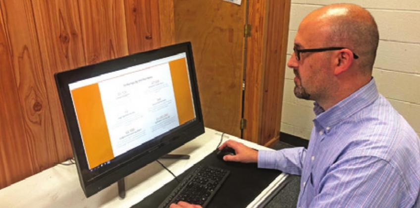 SNOOK ISD'S DIRECTOR OF CURRICULUM Jerod Neff looks at the University of Texas' OnRamps website. The dual enrollment program will allow students of Burleson County the opportunity to earn college credit in a low risk and low price option.