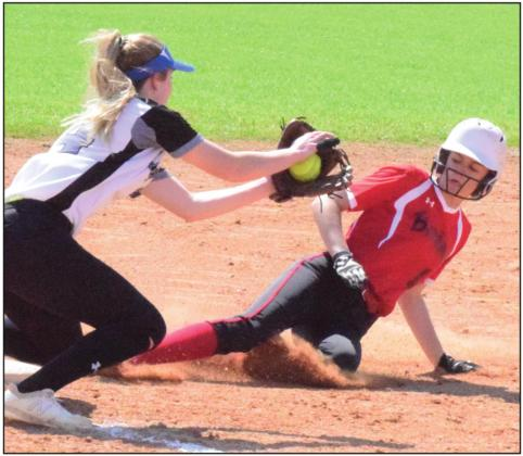 SNOOK'S JAYCIE BRISCO attempts to tag out an Iola runner at third base during a game in mid-March. The UIL recently released the 2020-2021 softball alignments. -- Tribune photo by Denise Hornaday