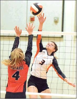 EMMA KOVASOVIC hit the ball over Richards' Kylie Bates during Somerville's win on Friday. -- Tribune photo by Denise Hornaday