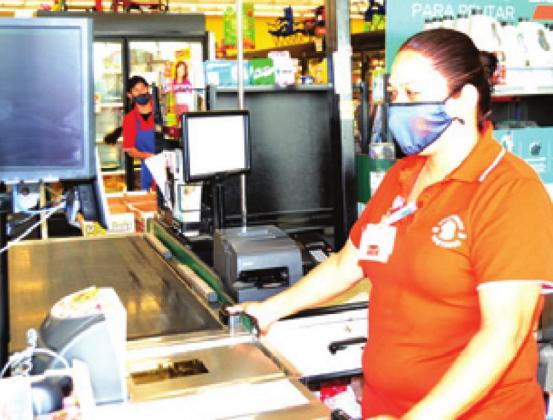 INASIA ARGUELLO wears a mask while working at Brookshire Brothers in Caldwell.