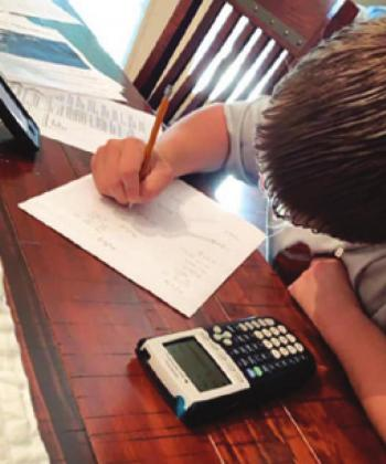 CALDWELL NINTH-grader Carson Parker is working on a math problem during the national coronavirus outbreak.